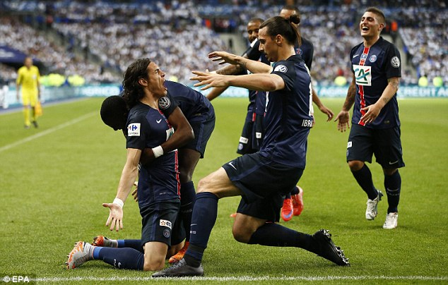 Cavani, who was linked with a move away  to Juventus earlier this month, is congratulated by his teammates