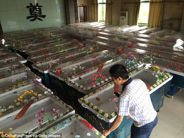 Fearing for worst: A crematorium in Jianli, the nearest town to the wreckage, is preparing hundreds of coffins