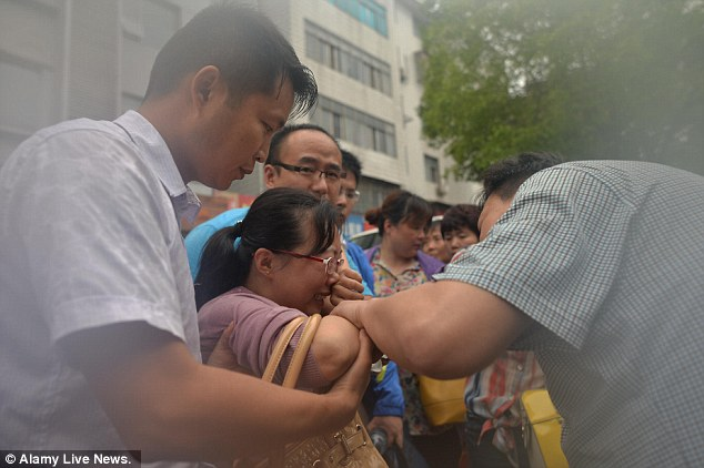 Grief: 26 people have been confirmed dead after the ferry overturned in the Yangtze river on Monday night