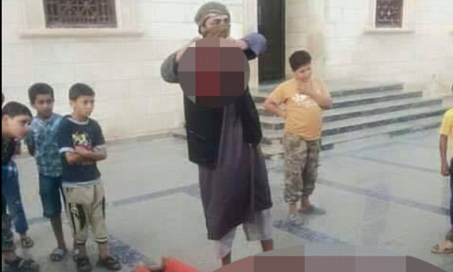ISIS beheads a Libyan soldier outside a Derna mosque for 'education purposes'