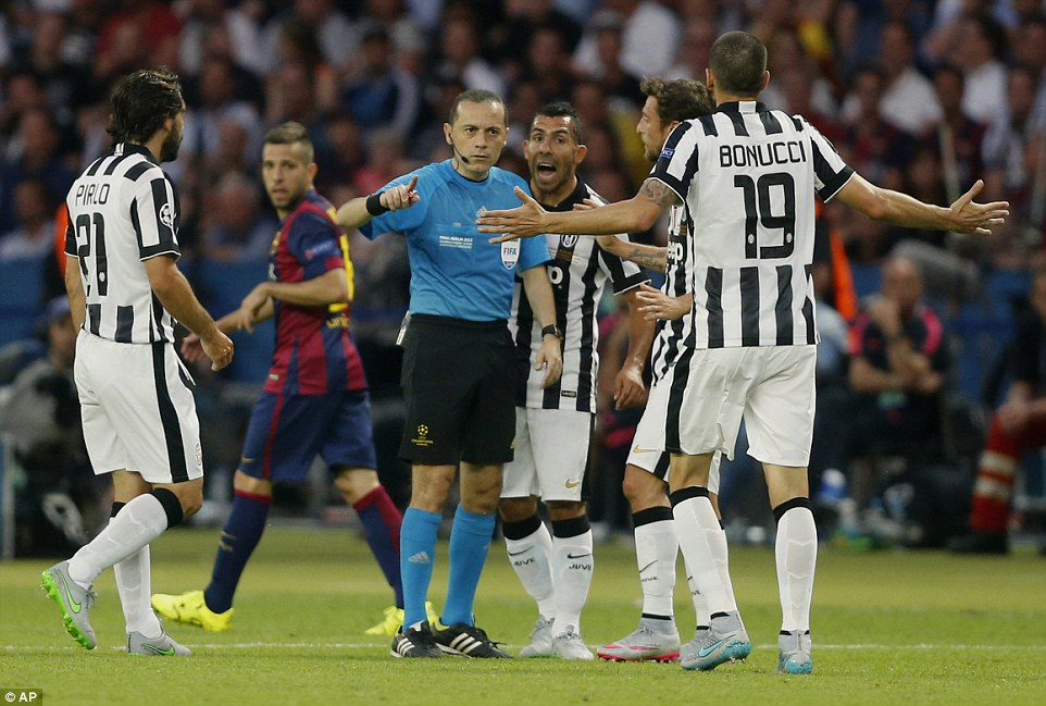 Incensed players from Juventus surround Cakir following the incident, but Alba's tackle went unpunished by the Turkish official