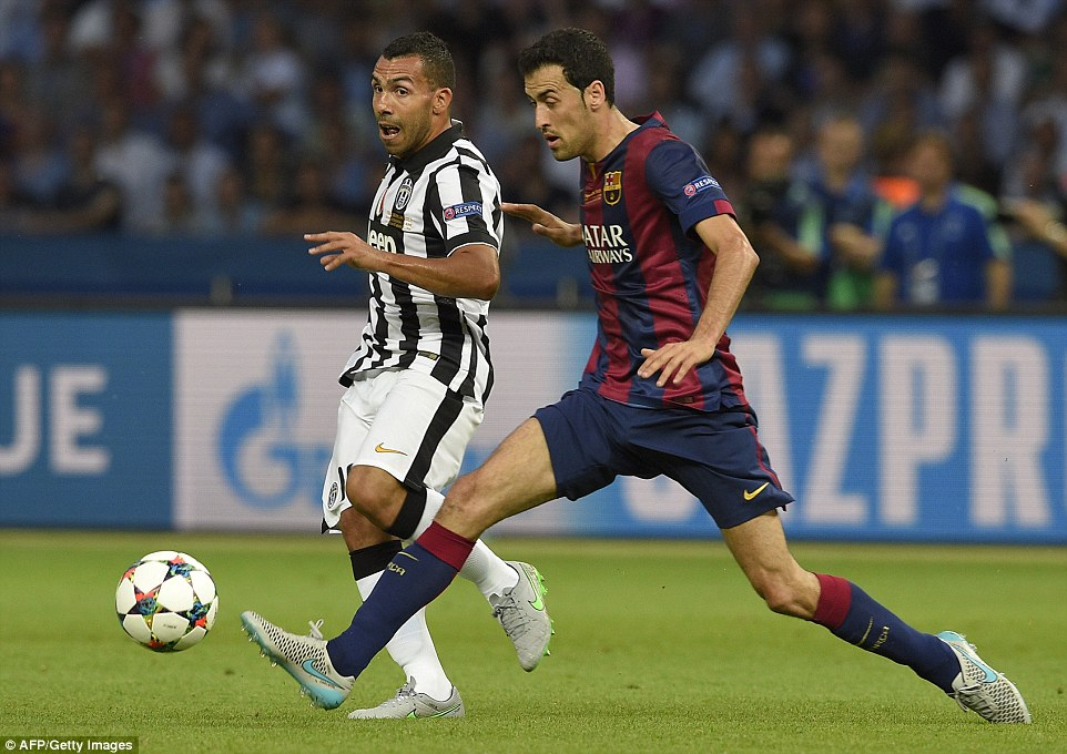 Carlos Tevez attempts to elude Sergio Busquets as the Argentine striker looks to find a Juventus shirt