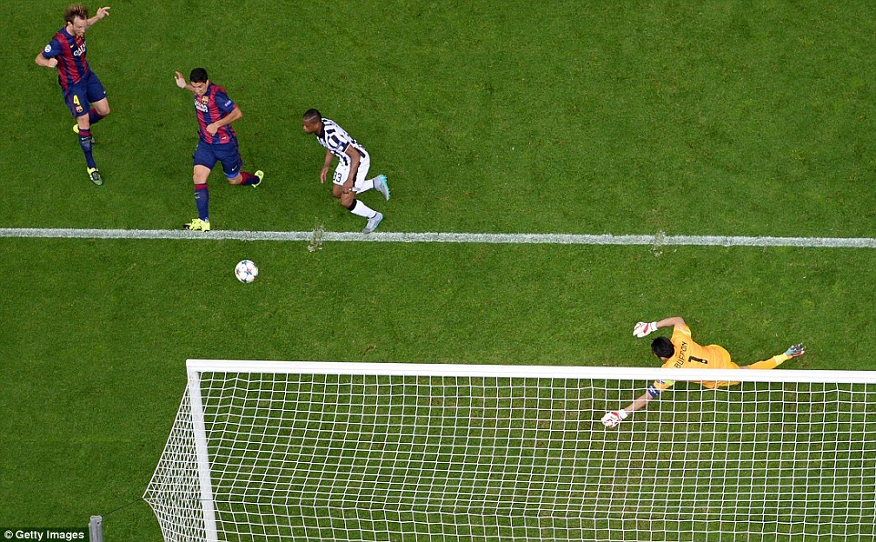 Suarez reacted quickest to the loose ball after Gianluigi Buffon parried Messi's shot, with the striker adjusting his body to sidefoot home