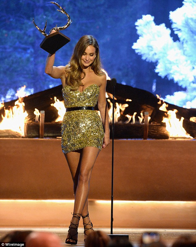 Shimmering: Model Hannah Davis looked gorgeous as she accepted the prize for Our New Girlfriend