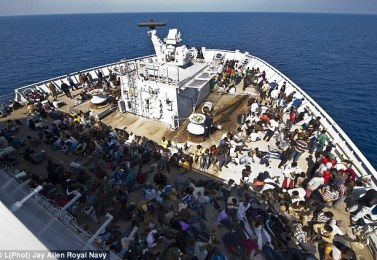 All aboard: Rescued migrants safely onboard HMS Bulwark in the Mediterranean during the biggest operation of its kind by the Royal Navy