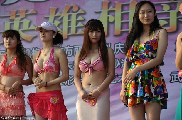 Matchmaking: A Chinese businessman has sued a dating agency for failing to find him the perfect wife, despite paying them £740,000. Dating events (pictured) are popular in the country and sometimes include bikini shows