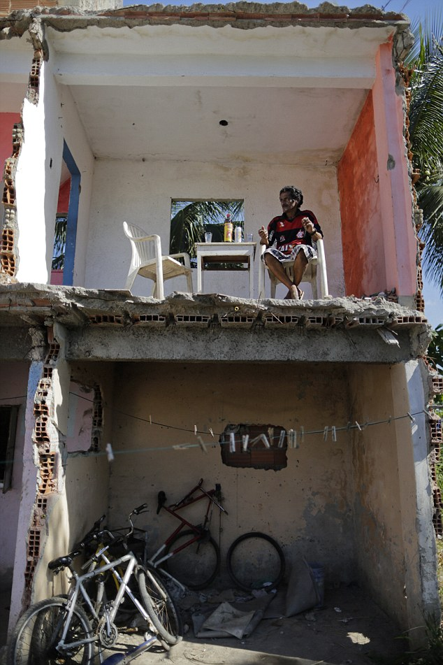 Luis, who moved to the Vila Autodromo after arriving in Rio from Brazil's northeast 25 years ago in search of a better life, said authorities offered him just £20,000 for the four-bedroomed home in from of the picturesque Jacarepagua lake - a fraction of what he claims it was worth