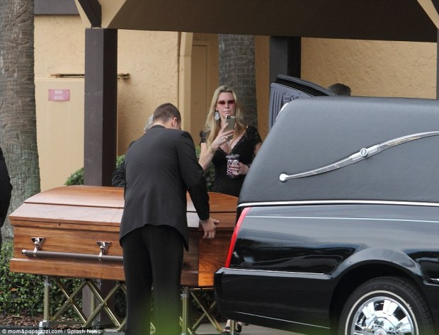 Siegel appeared to capture the somber moment when her daughter's casket was being placed into the hearse with her cameraphone