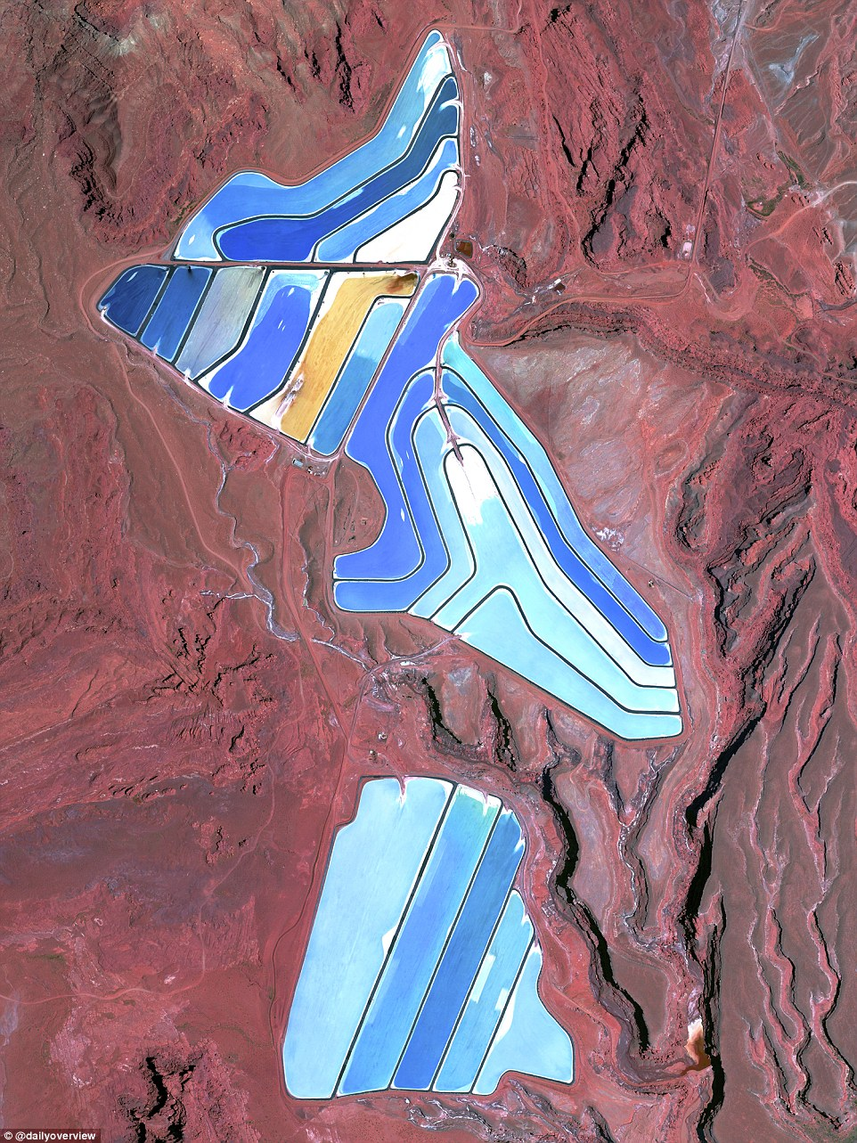 The Moab Potash Ponds in Utah is a stunning example of vibrant colour contrast between the bright blue water and salt