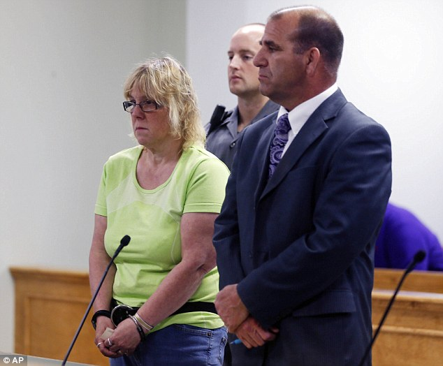 Terrified: With her hands shaking and her lips pressed together, Joyce Mitchell, who allegedly helped two murderers escape from a New York state prison last weekend, was arraigned late Friday night. Above, Mitchell is pictured standing beside her defense attorney during her arraignment in Plattsburgh, New York