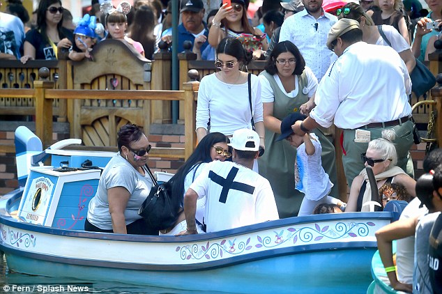 Safety first: The rumoured couple chatted it up as other patrons loaded up the small vessel