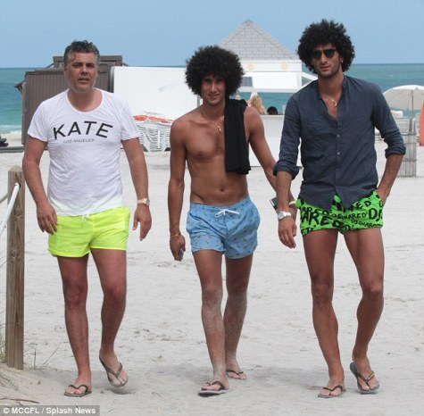 The 27-year-old (right) is currently enjoying the Miami sunshine with his twin brother Mansour (centre)