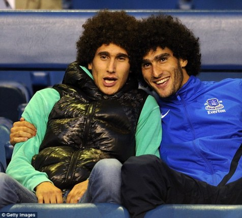 Fellaini (right) poses with his twin brother Mansour during his days as an Everton player