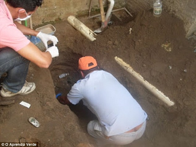 Grim discovery: The bones of Gicelly Helena da Silva and Alexandra Silva Falcao, 20, were found buried in the house's back yard after their arrest