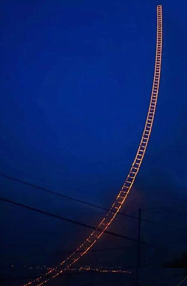 Sky Ladder: A Chinese artist has created this incredible burning ladder that stretches for 1,650ft into the sky