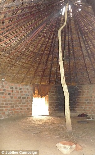 Atrocity: Boys like Allan are taken to witch doctor's huts like this one, where they are held down and mutilated