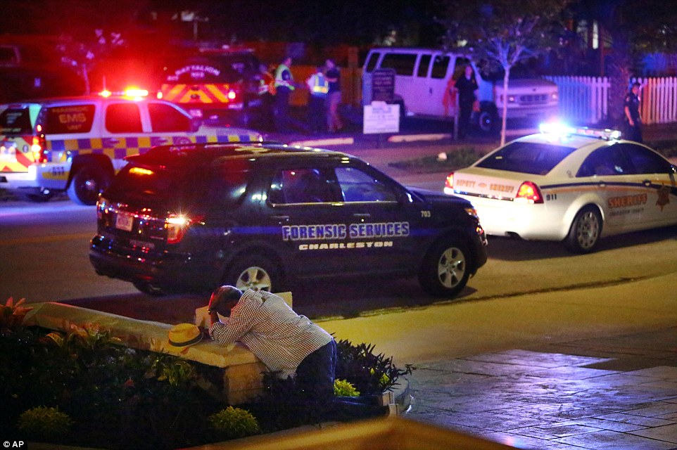 Scene of horror: Emergency personnel and investigators gather outside the church after the shooting on Wednesday night