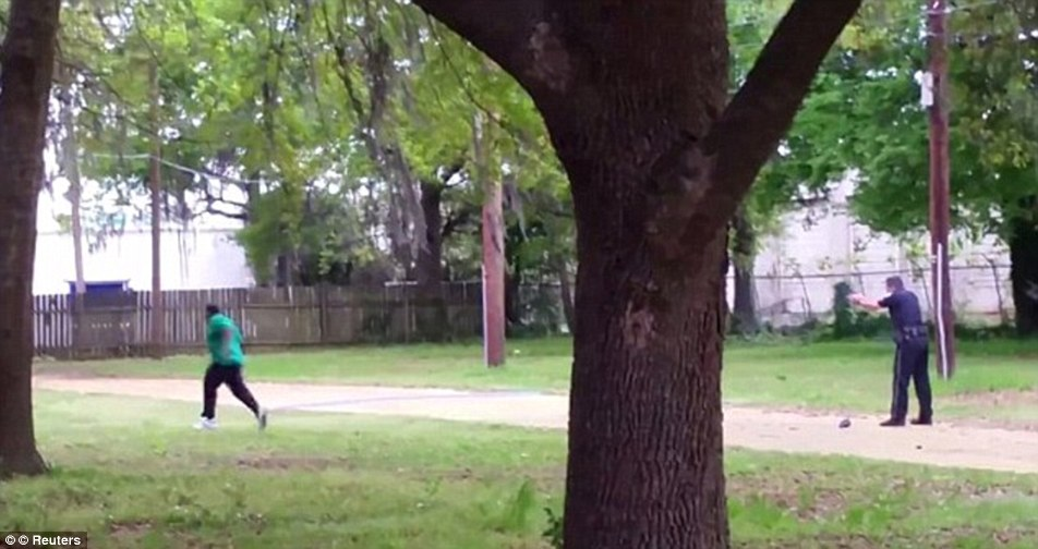Unarmed black man Walter Scott, who was shot dead by a white police officer, pictured, in South Carolina last month