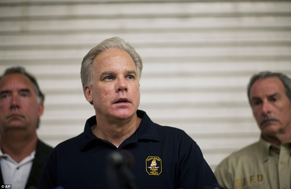 Updated: Charleston Police Chief Gregory Mullen speaks during a news conference on Thursday as the search for the gunman continues