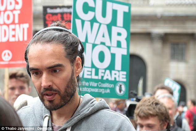 Comedian Russell Brand (pictured) was also seen marching from  the financial district to Parliament
