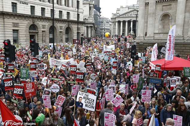 Tens of thousands of demonstrators with placards crowded the area around the Bank of England