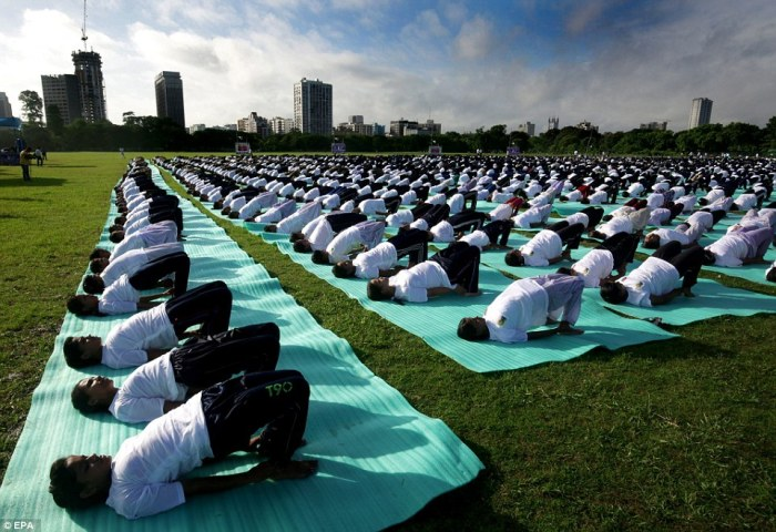 Thousands of Indian National Cadet Corps (NCC) boys and girls participate in a mass yoga session near Victoria Memorial in Calcutta