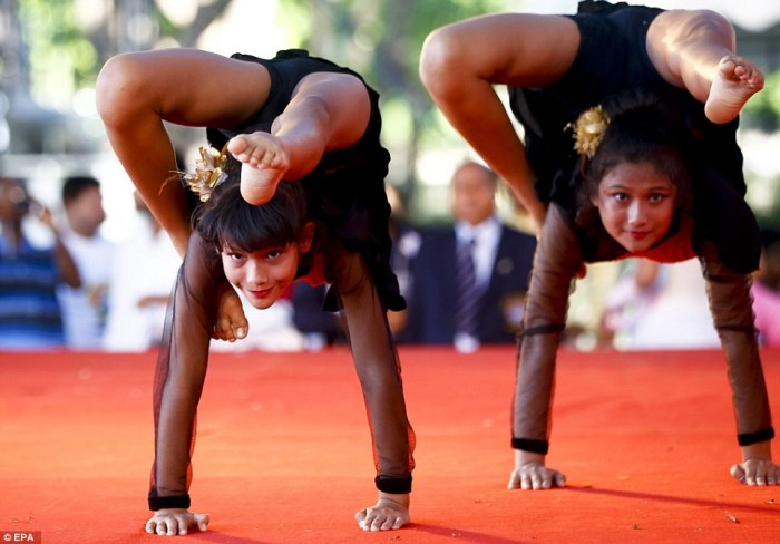 Young Indian yoga students are seen here performing in Bangkok, Thailand, in honour of the day