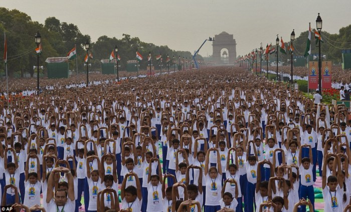 Indians perform yoga on Rajpath, in New Delhi, India