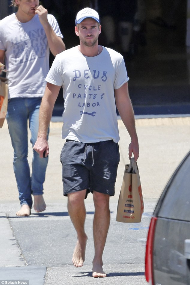 Liam Hemsworth Shows Off His Cheeky Side After A Wetsuit