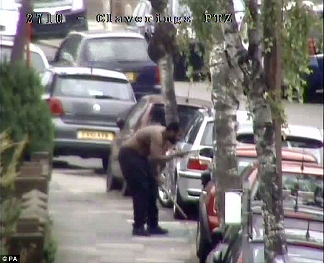 The paranoid schizophrenic was captured on police camera storming through back gardens in Edmonton, north London, before attacking 82-year-old Italian café owner Palmira Silva with a machete