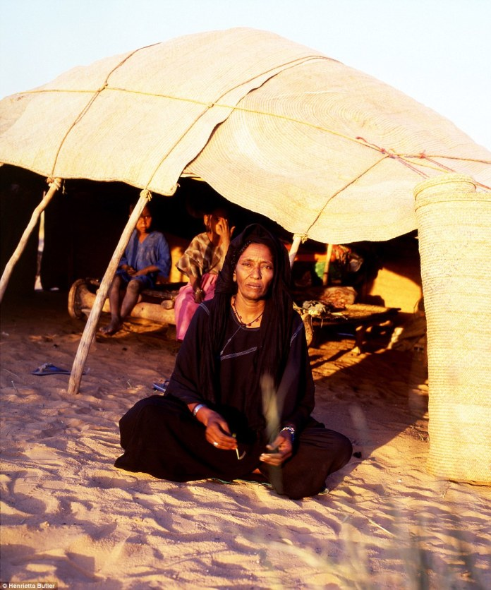Owner: A nomadic Tuareg woman in front of her tent, with younger children sit inside. The mother's tent is the heart of the family