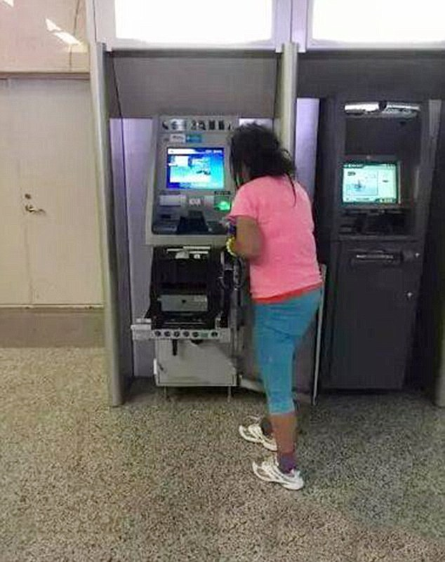 Wrongly believing that the cash machine had swallowed her card, a frustrated woman rips apart ATM in China