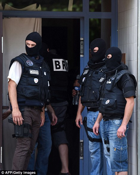 Special forces working for France's Research and Intervention Brigades  enter Yassine Salhi's apartment building