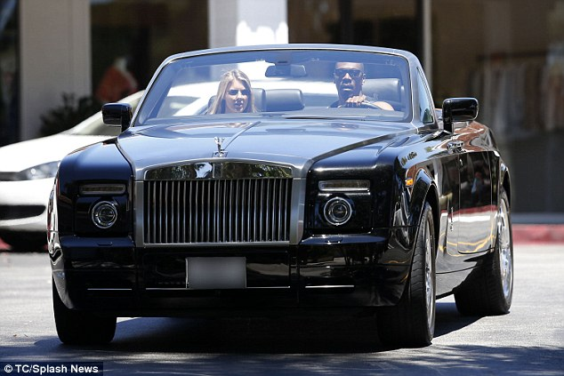 Hot wheels: The Shrek star took his Rolls Royce Phantom convertible for their trip, worth nearly $500,000