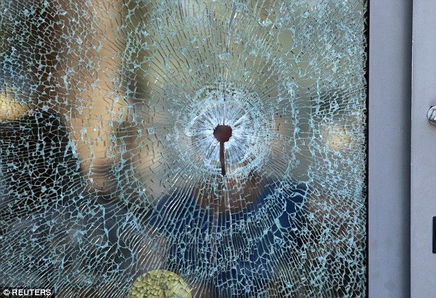 Attack: A broken glass window of the Imperial Marhaba hotel is seen after a gunman opened fire at the beachside hotel in Sousse