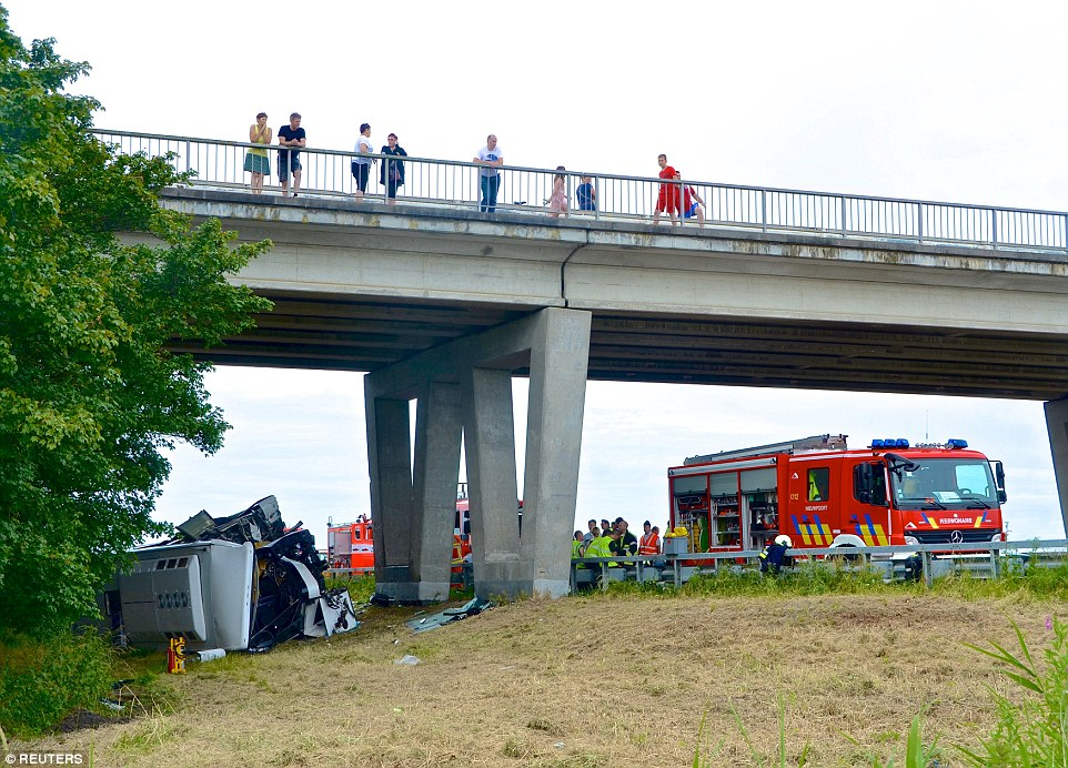 The accident happened just before 10am and ambulances and fire engines raced to the scene at the side of the motorway where the bus overturned