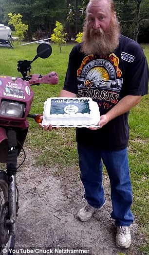 Netzhammer shows off the ISIS-themed cake, which Walmart has since apologized for baking