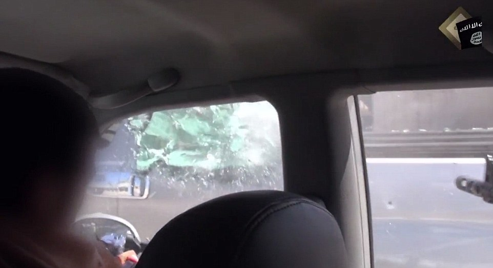 The brief grainy footage appears to have been filmed on a mobile phone by one of the passengers in the militant's car