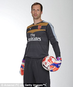 The Gunners veteran keeper poses with a Arsenal customised football