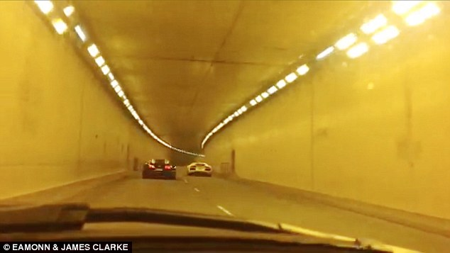 Taking the lead: In a swift movement, the Lamborghini zooms ahead of the Bugatti and drives out of the tunnel