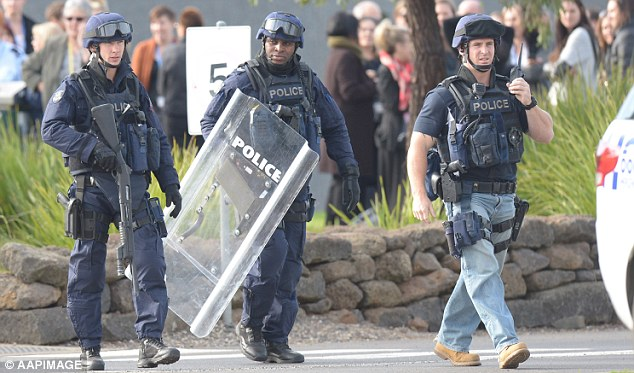 Heavily armed: Officers gather outside the remand centre as prisoners riot inside