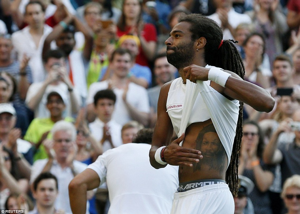 The German tennis player, who lit up Centre Court today, pats a giant tattoo after winning the pulsating match at Wimbledon today. Dustin has reportedly said it is a tattoo of his father Leroy; however commentator Andrew Castle said it was the singer Dennis Brown