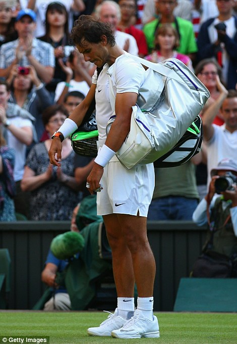 Rafael Nadal looks downbeat after the match