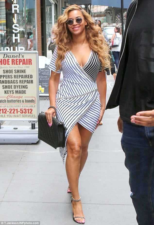 Working it: Beyonce stepped out in another super stylish outfit on Thursday as she made her way to her office in New York
