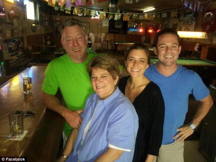 Happier times; Kate Steinle poses with her mother Liz, her father Jim, and her brother Brad at her father's 65 birthday celebration in Pleasanton