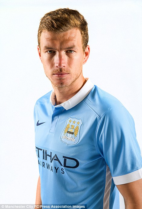 Bosnian striker Edin Dzeko models Manchester City's new kit