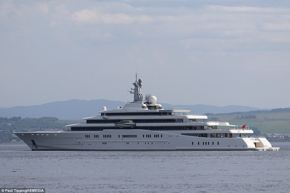 Luxury: The 48-year-old has been travelling on board his 557ft, £1.5billion super yacht, Eclipse, as it sails the Firth of Clyde. Above, the Eclipse on the River Clyde from Greenock