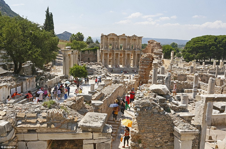 Tourists walk through the ancient Greek and Roman settlements at Ephesus in Turkey, once the site of the Temple of Artemis