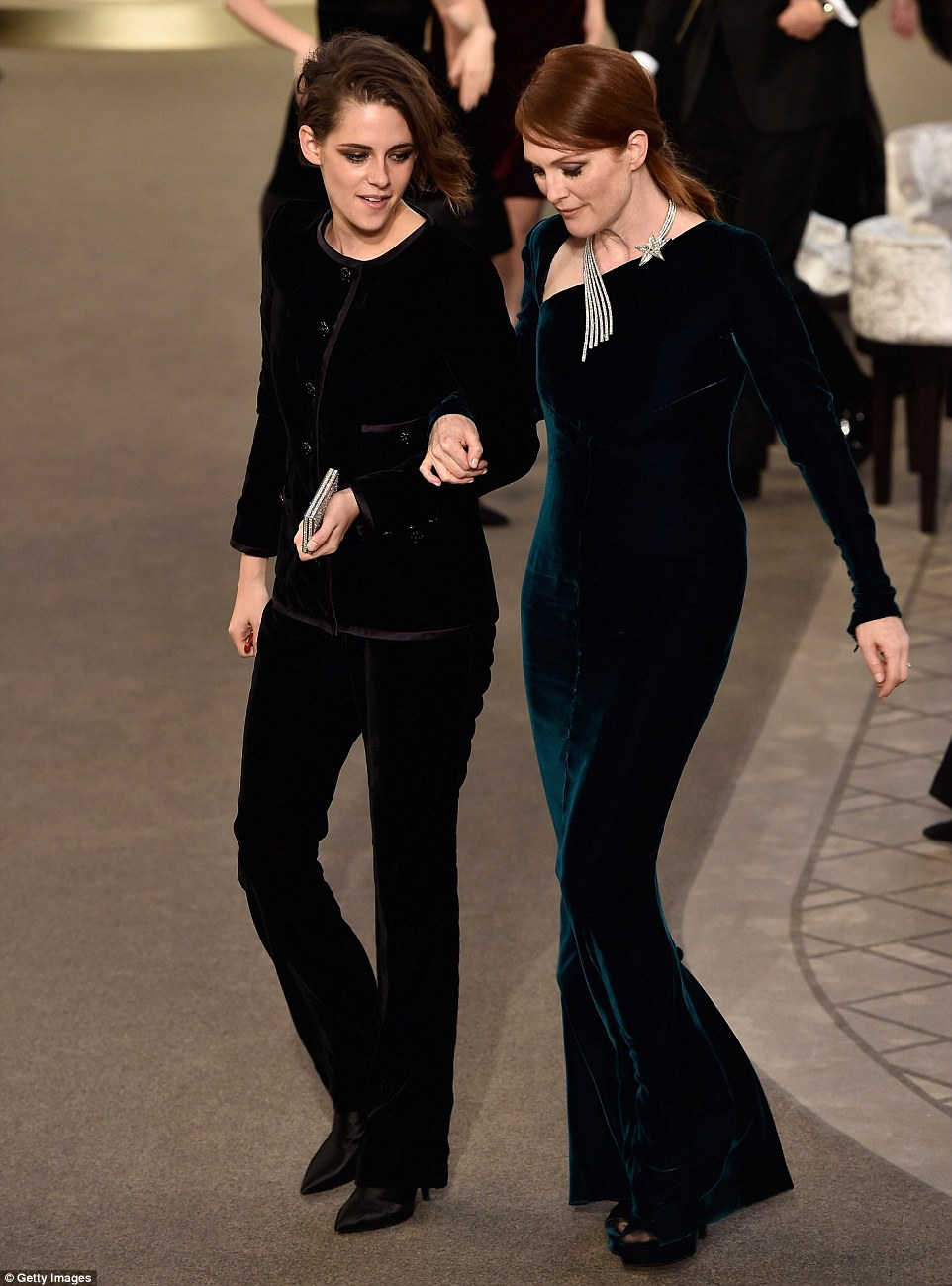 Stylish pair: Kristen Stewart and Julianne Moore, who played mother and daughter in the 2015 Oscar winning film Still Alice, wowed in glam velvet ensembles as they took part in the show