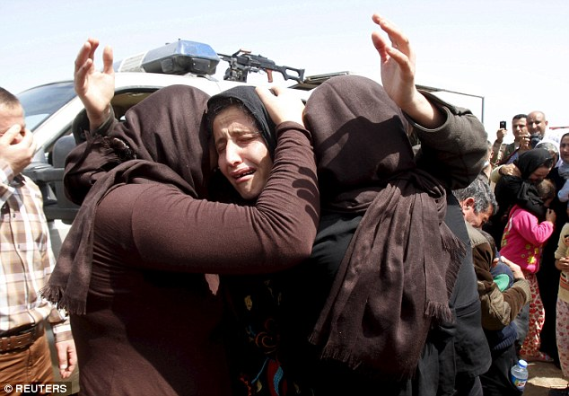 Cruelty: ISIS has carried out the 'systematic sexual crimes' against Yazidi women (pictured after being released in April) since kidnapping over 200 of them from their homes in northern Iraq last August